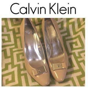 NWOT Calvin Klein Tan Patent Pumps. Size 10